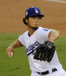 Dodgers starting pitcher Yu Darvish throws in the World Series