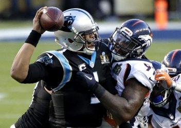 Broncos Malik Jackson makes contact with Panthers Cam Newton