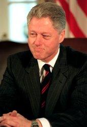President Bill Clinton attends a meeting