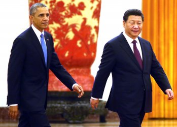 Obama attends a welcoming ceremony in Beijing