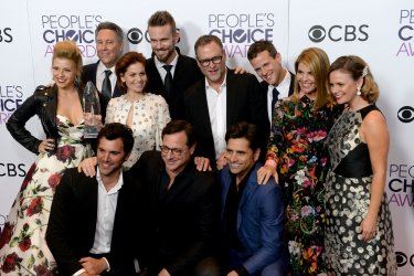 Jodie Sweetin, Jeff Franklin, Candace Cameron Bure, John Brotherton, Dave Coulier, Scott Weinger, Lori Loughlin, Andrea Barber, Juan Pablo Di Pace, Bob Saget and John Stamos win an award at the People's Choice Awards in Los Angeles