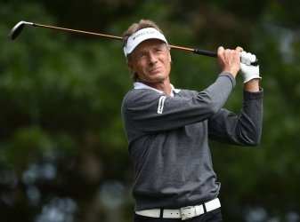 Bernhard Langer hits a tee shot at the Masters