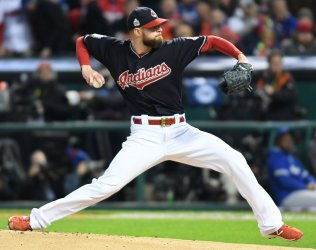 Indians pitcher Kluber sets World Series record with 8 strikeouts during the first three inning against the Cubs in Game 1