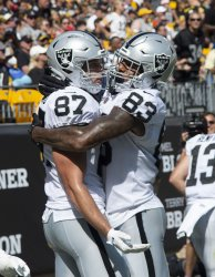 Raiders Foster Moreau Celebrates Touchdown in Pittsburgh