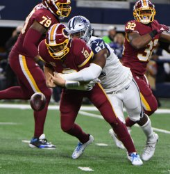 Washington Redskins Kirk Cousins fumbles as he is hit by Dallas Cowboys Taco Charlton