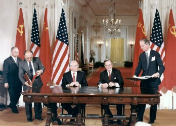 Presidents Gorbachev and Bush stand at the White House for the signing of historic Summit meeting treaties