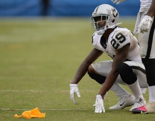 Raiders  cornerback David Amerson grimaces after getting called for pass interference