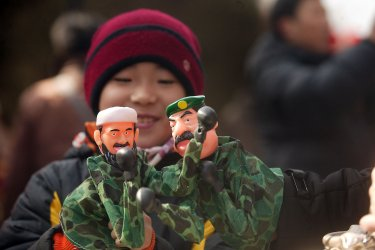 Holiday crowds enjoy the first day of the Chinese New Year in Beijing