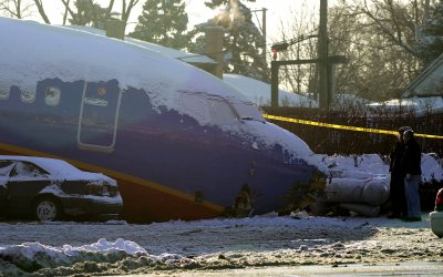 Southwest Airlines plane crashed through a safety wall while atempting to land during a snowstorm
