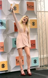 Kelsea Ballerini wins an award backstage at the 51st  annual Academy of Country Music Awards in Las Vegas