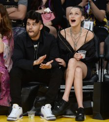 The Weekend and Bella Hadid attend Kobe Bryant's final game as a Laker in Los Angeles