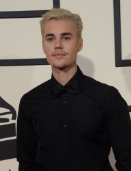 Justin Bieber arrives for the 58th annual Grammy Awards in Los Angeles