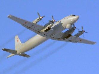A Russian Ilyushin IL-38 flies over Sea of Japan
