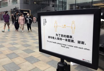 Signs encourage people to practice safe social-distancing  in Beijing, China