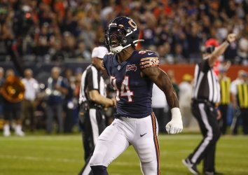 Bears outside linebacker Leonard Floyd celebrates after a defensive play in Chicago