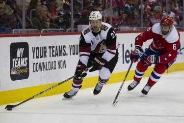 Arizona Coyotes center Derek Stepan carries the puck while defended by Washington Capitals defenseman Michal Kempny