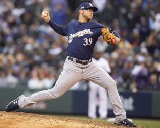 Brewers Burnes earns win in relief in NLDS Game Three