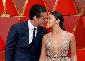 Joe LoCicero and Gina Rodriguez arrive for the 90th annual Academy Awards in Hollywood