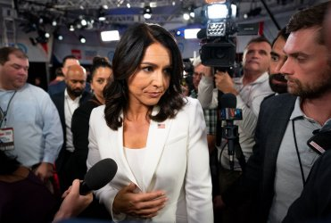 Tulsi Gabbard speaks to the media at the CNN Democratic Debate in Detroit