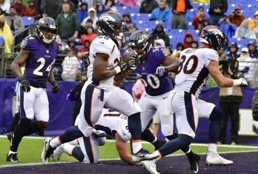 Broncos' Royce Freeman scores TD during an NFL game in Baltimore