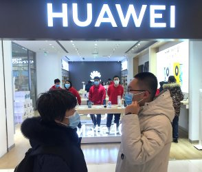 Chinese Work at a Huawei Store in Beijing, China