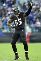 Ravens linebacker Terrell Suggs celebrates a Bengals turnover