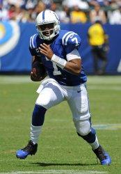 Indianapolis Colts quarterback Jacoby Brissett runs for a gain