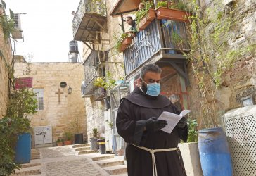 A Catholic Priest Wears A Protective Mask And Gloves Olive On Palm Sunday