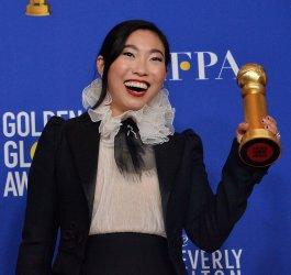 Awkwafina wins an award at the 77th Golden Globe Awards in Beverly Hills