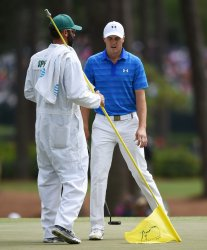 Jordan Spieth reacts after a putt on the 3rd hole at the Masters