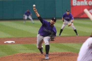 Colorado Rockies starting pitcher Antonio Senzatela delivers pitch