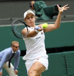 Ashleigh Barty returns in her match against Harriet Dart