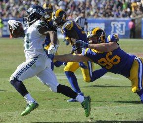 Seattle Seahawks'  J.D. McKissic gets away from Rams Matt Longacre in Los Angeles, California