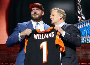 Jonah Williams receives a jersey from NFL Commissioner Roger Goodell