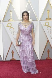 Salma Hayek arrives at the 90th Annual Academy Awards in Hollywood