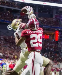 Florida State's Auden Tate goes up for a touchdown reception against Alabama
