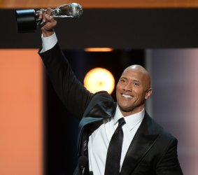 Dwayne Johnson accepts the award for Entertainer of the Year at NAACP Image Awards in Pasadena