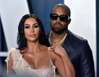 Kim Kardashian and Kanye West attend Vanity Fair Oscar party