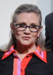 Carrie Fisher attends the EE British Academy Film Awards in London