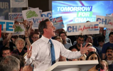 Conservative David Cameron talks to his supporters at campaign rally in England