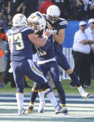 Chargers Keenan Allen is congratulated by teammates after recovering a fumble and running it in for a touchdown in Carson, California