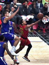 Hawks guard Trae Young (R) shoots over Clippers center Ivica Zubac (L) at Staples Center