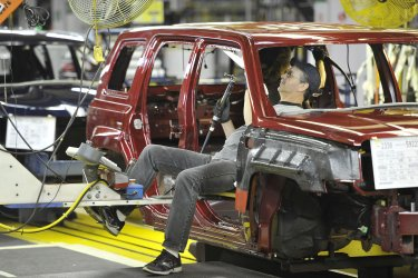 Chryler Worker Adds part to Car in Belvidere, Illinois