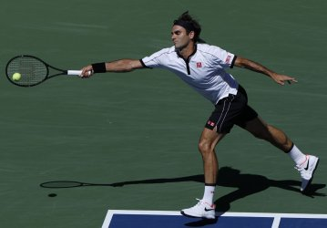 Roger Federer reaches to return a ball at the US Open