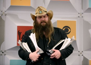 Chris Stapleton wins an award backstage at the 51st  annual Academy of Country Music Awards in Las Vegas