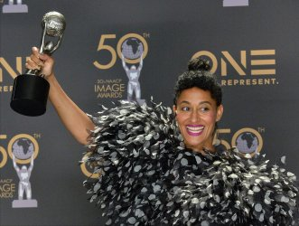 Tracee Ellis Ross wins award at the 50th NAACP Image Awards in Los Angeles