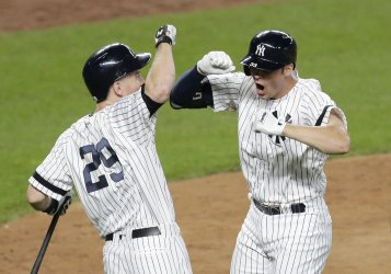 New York Yankees Greg Bird celebrates with Todd Frazier