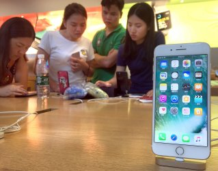 Chinese look at iPhones on display in Beijing, China