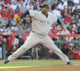 New York Yankees starting pitcher CC Sabathia pitches in the first inning