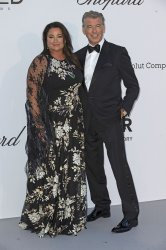 Keely and Pierce Brosnan attend the amfAR Gala in Antibes
